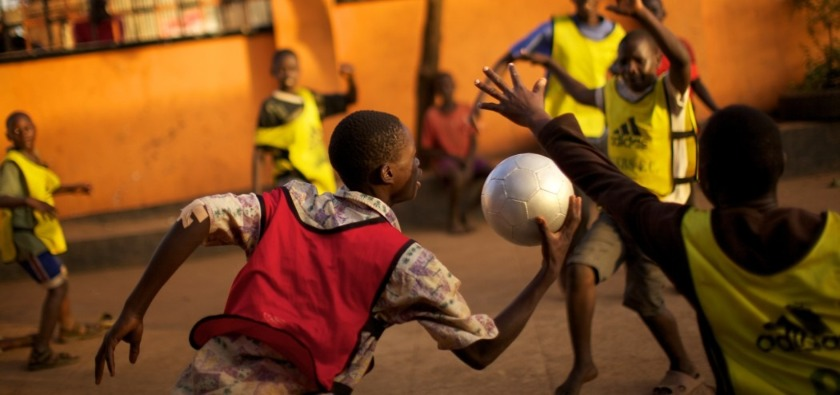 African boys playing with a soccer ball